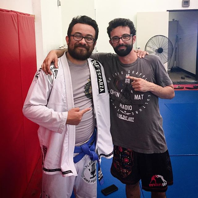 "I'm pretty selective about who I let be my bjj podcast arch nemesis. There are many pretenders who try to take the prestigious position, but none more deserving than @paulopenmatradio.  I was thrilled to find out this time last week that Paul had achieved an important distinction in his jiu-jitsu journey, that of being awarded an extremely well-deserved rank of Black Belt.  Not just from anyone mind you. A black belt from the esteemed Sergio Penha.  Having the unfortunate pleasure of knowing Paul for the better parts of four years now, I can tell you, the black belt is more than a reflection of his excellent work as a martial artist and instructor, it's also an acknowledgement of the man's contribution to our sport.  That much I can speak on.  There are only a handful of us in this broadcasting game, and Paul's genuine love of grappling has shone through on every single episode of Open Mat Radio. From his insightful line of questioning to his steadfast resolve in promoting the art to his sincere care for the athletes, Paul has cultivated a strong reputation as one of the very best in our field.  Which is why when you go about the business of choosing ""rivals"" in your sport, you go about looking for those who raise your game. Who are the first to call and congratulate you when they see your show blow up. And those who gleefully play along with every joke you tell, as if you've been friends for decades.  I always like to call Paul the Edward R. Murrow of our sport -- an individual who is not afraid to speak his mind and who thoughtfully and fiercely stands up for what he believes in.  Individually, our shows and styles couldn't be more different. But together, there's always been a mutual respect for the manner in which we go about promoting the sport.  Tomorrow I'll go back to outright insulting him (as rivals and -- more specifically -- bjj podcast arch nemesi do), but today I'd like to send a set of congratulations to next chapter in the journey of one Paul Moran. I'm extremely happy for you pal."
