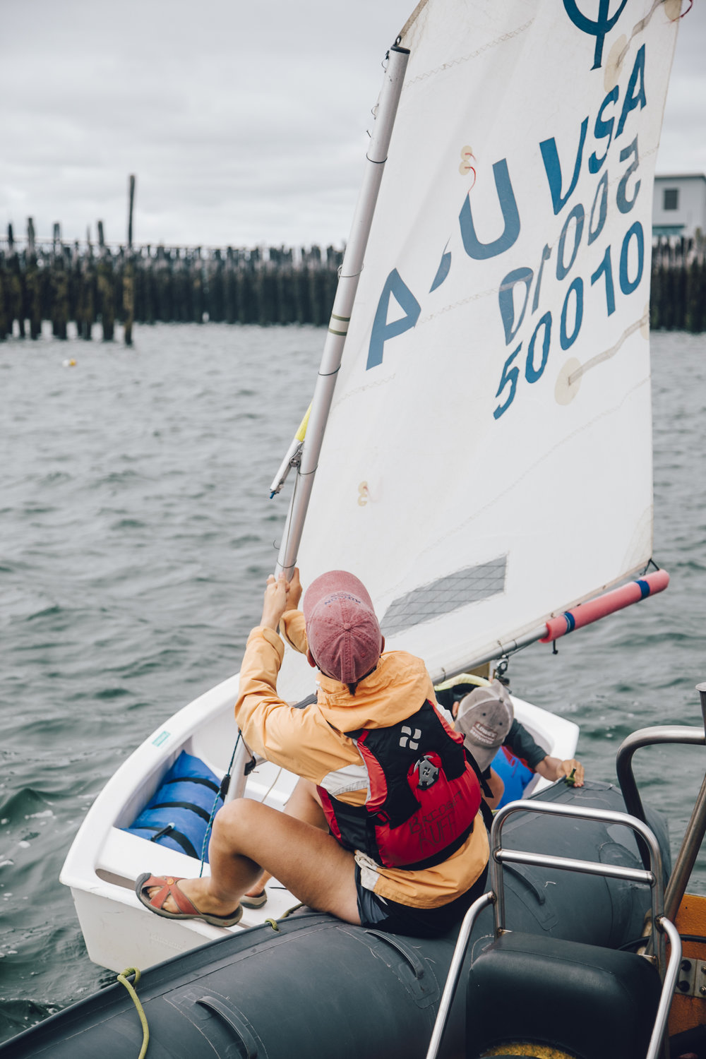 Bridget Ruff helps students set out to sail. Photo © Jenny Rebecca Nelson