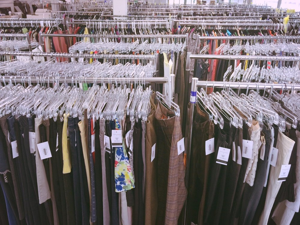 Inventory of used designer clothing at Material World.