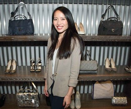 Jie in front of showcased inventory at Material World.