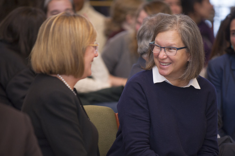 Smith College President  McCartney (left) and Elizabeth Miller '81 (right) engaging in an improv exercise led by Busy Burr '83.