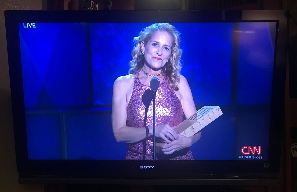 Susan receiving a recognition as CNN Hero for her work in the fight against sex-trafficking.