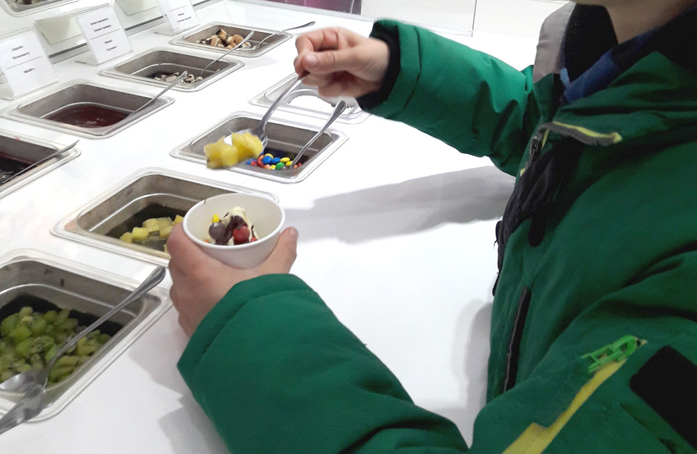 Adding toppings to IceBox icecream.