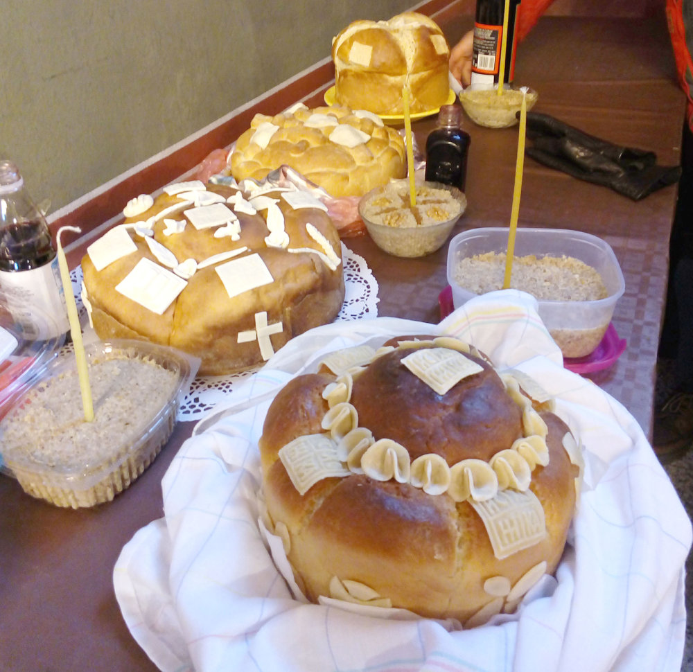 Slavski Kolač (Slava Bread), ours is the tall one at the back! The 'Žito' has a candle in it.