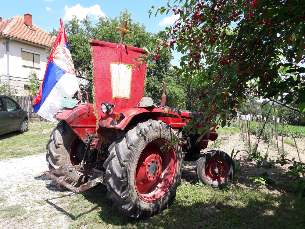 Tractor decked out to process around the village