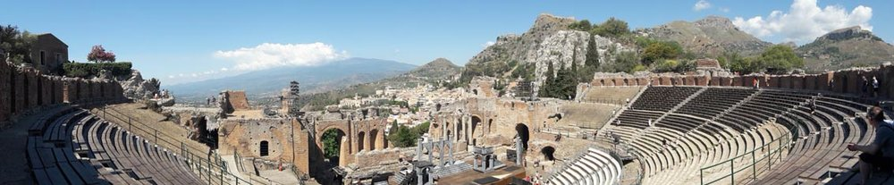 Ancient Theatre in Taormina with Mount Etna in the distance
