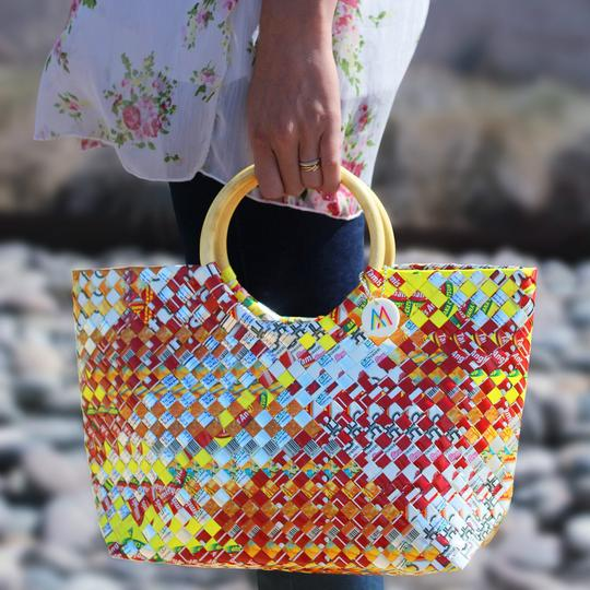"Mother Erth empowers artisan moms and reduces plastic pollution. ""Sustainability woven into fashion."""