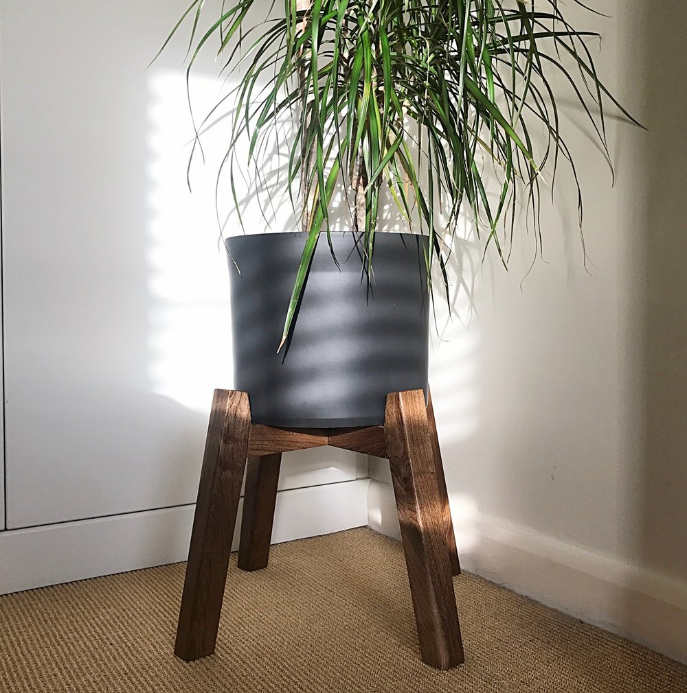 Collaboration - Whilst production is down to me, the design process should be a collaboration between myself and the customer.This plant stand was inspired by one found in a magazine by the customer. I designed the structure based on the customers brief and the existing plant pot. The English walnut used works beautifully with the black ceramic pot.