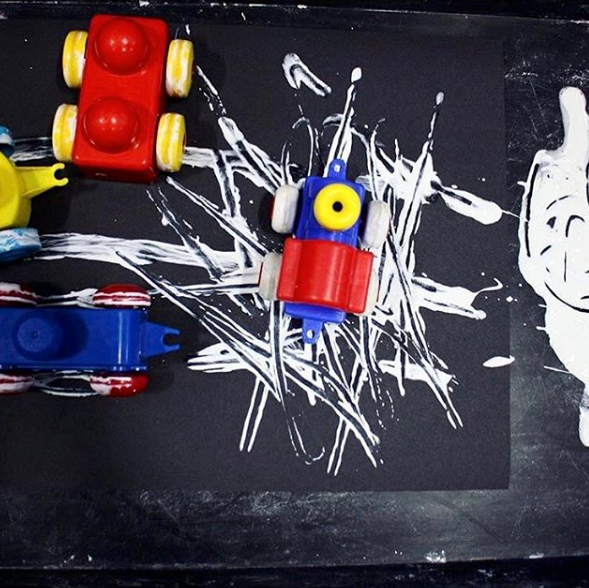mark making - Driving trains through white paint on black paper is a great mark making activity for early writers. @oursensorykids