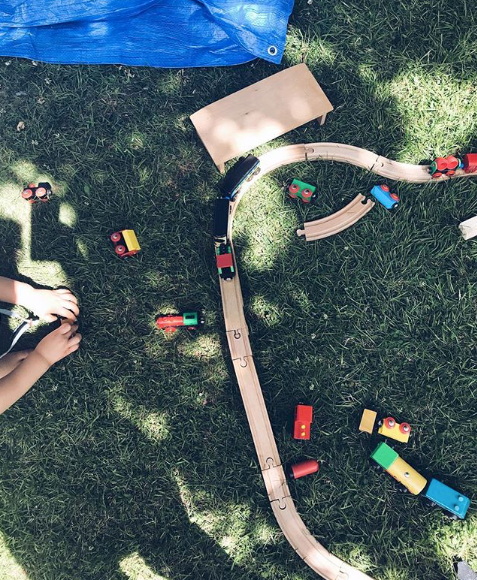OutdoorPlay - Why not set up your train tracks outside under the shade of a tree?@oursensorykids