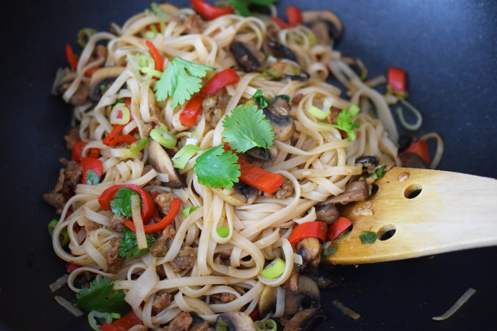 SWIFT AND SPICY SIRKKIS® WOK (2 portions) - Egg noodlesOlive oil1 tsp of red curry paste~ heaping tsp offresh ginger, grated3 cloves of garlic,crushed3 tbsp of soy sauceCilantro, coarselychopped1 sweet red pepper5 to 10 mushrooms,sliced2 whole spring onionsfinely chopped1,5 -2 dl Sirkkis®