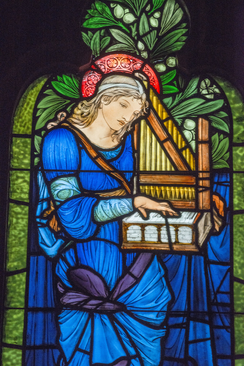 Saint Cecilia holding a hand organ. Designed by Edward Burne-Jones Photo credit: Martin Cheung