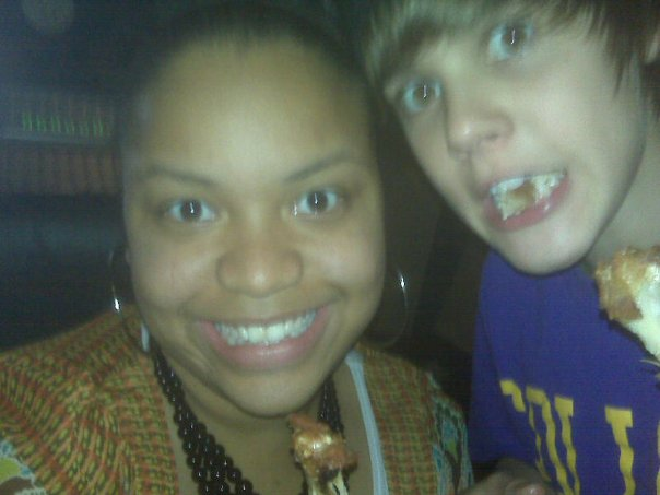 "Anesha and a young Justin Bieber enjoying some chicken wings after recording  ""Favorite Girl    "" . This song is available on Justin's first album,  My World ."