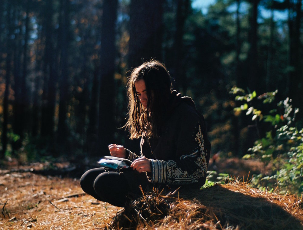 woman writing in woods cropped.jpg