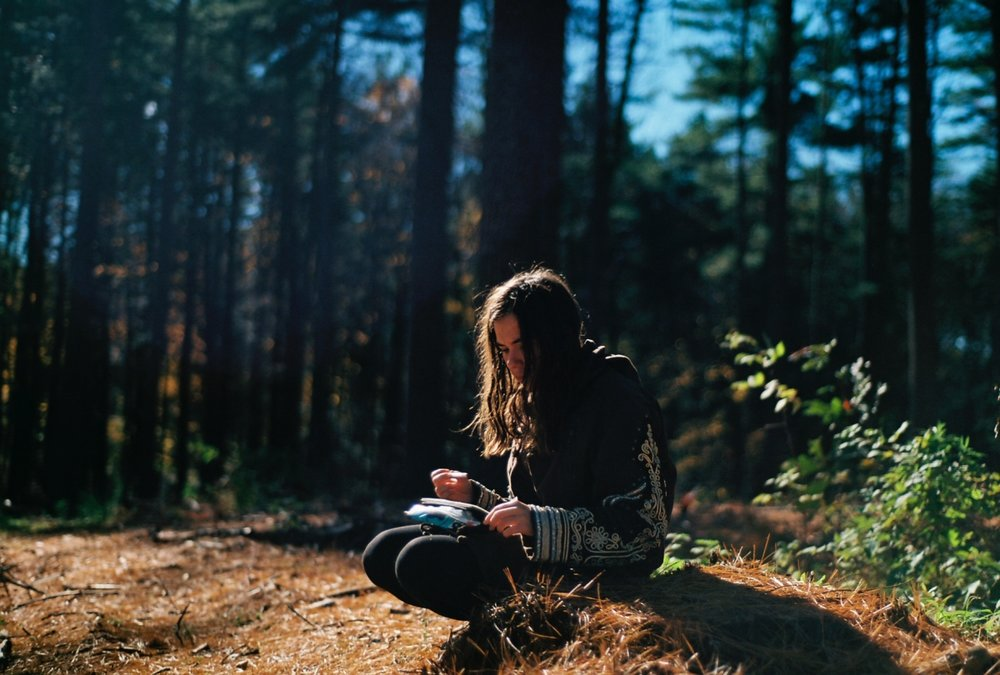 Optimized-woman journaling in woods.jpg