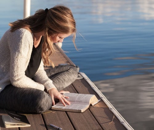 woman reading on dock.jpeg