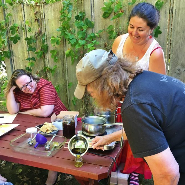 Hands-on herbs - Plan on taking home multiple hand-made herbal tinctures, oils and salves. Here Latisha is helping participants make cedar salve.