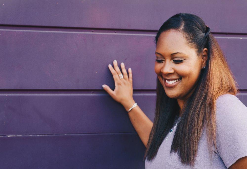 Optimized-black woman purple wall.jpg