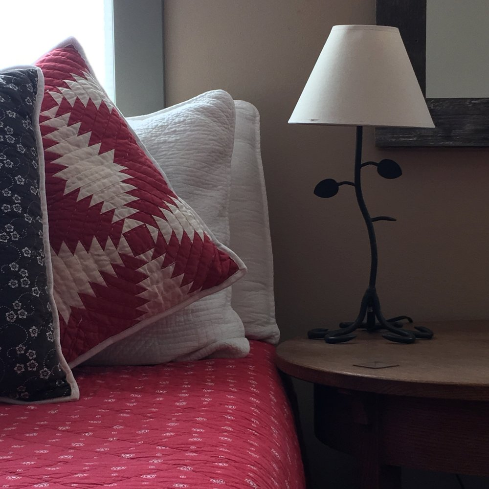 close up red bed pillows.jpg