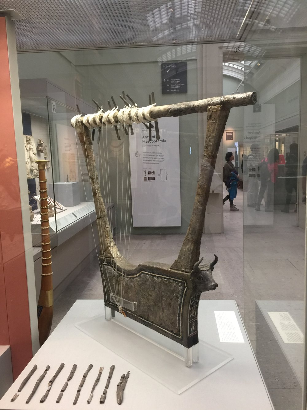 Silver lyre discovered in the Royal Cemetery at Ur in the Great Death Pit, appx 2500 BC. The silver is original and was removed by pouring plaster into holes left by disintegrated wood to maintain shape. The strings and pegs were added after excavation.