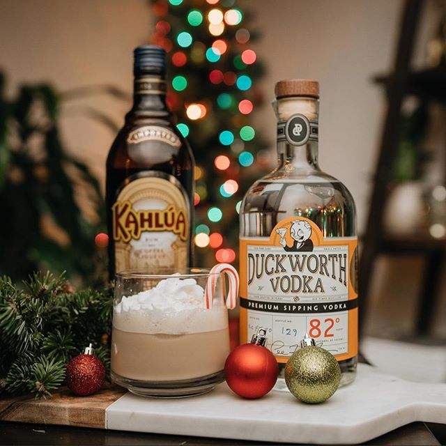 "Merry Christmas and Happy Holidays from all of us at Duckworth Vodka. Make minty chocolatey ""I'm Dreaming of a White (Russian) Christmas"" cocktail for your family and friends to warm their spirits! ⬅️⬅️Swipe left to see the recipe step by step. • 1 1/2 oz Duckworth Sipping Vodka 1 1/2 oz Kahlúa 2 oz milk  Whipped cream Peppermint Candy • Add 1 piece of peppermint candy to the kahlúa. Muddle (getting the candy flavor mixed) into the Kahlua. Pour ingredients into shaker, and shake vigorously. Strain any candy from the Kahlua. In a shaker, add ice, vodka, peppermint flavored Kahlua, and milk. Shake well, and strain mix in glass. Top with whipped cream, and garnish with a candy peppermint stick. - Recipe by Lisa and Suzanne • • • • #MerryChristmas #HappyHolidays #WhiteRussian #holidays #holidaydrinks #vodka #duckworthvodka #frenchoakvodka #texas #texasvodka #dallasdistillery #dallasvodka #bartender #cocktail #mixologist #dallas #austin #adultbeverage #cocktails #smoothvodka #bestvodka"