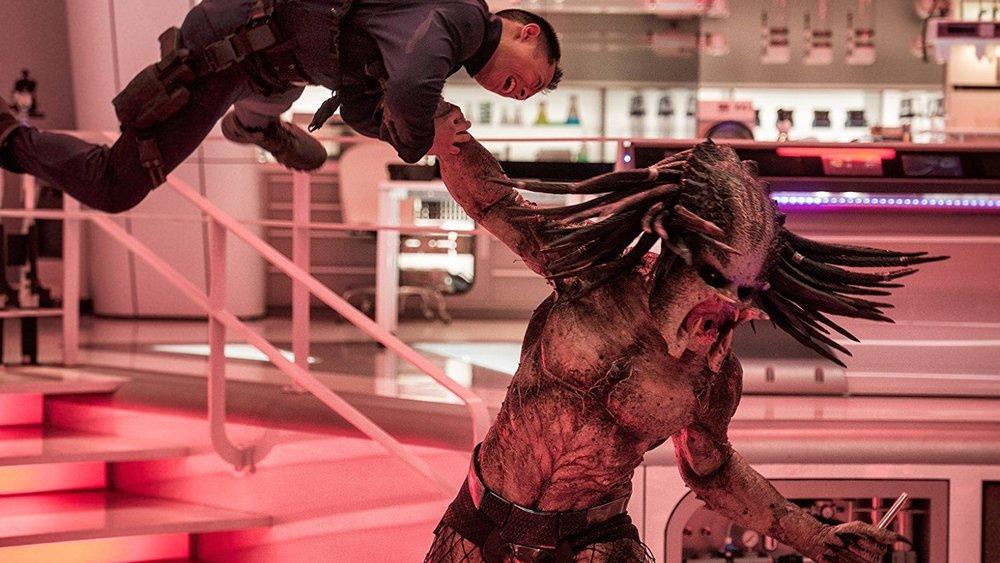 the-predator-hold-man.jpg
