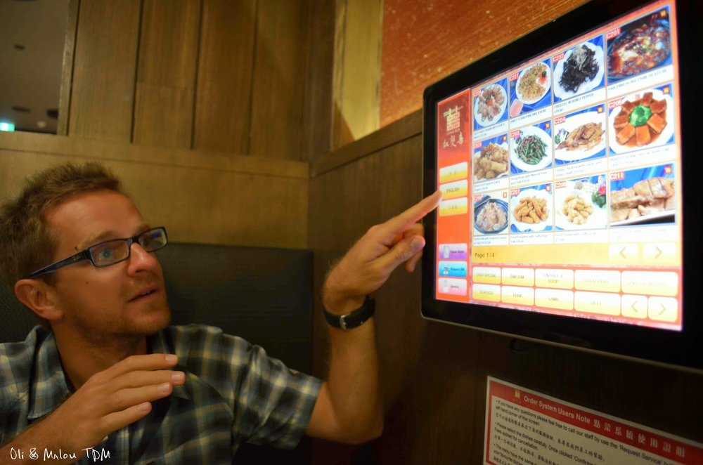 Oli excited to order food via touch screen at China Red.  Image by Oli & Ma Lou.