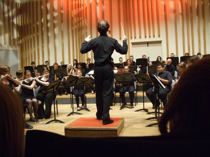 Conducting Manchester University Wind Orchestra (July 2011).jpg