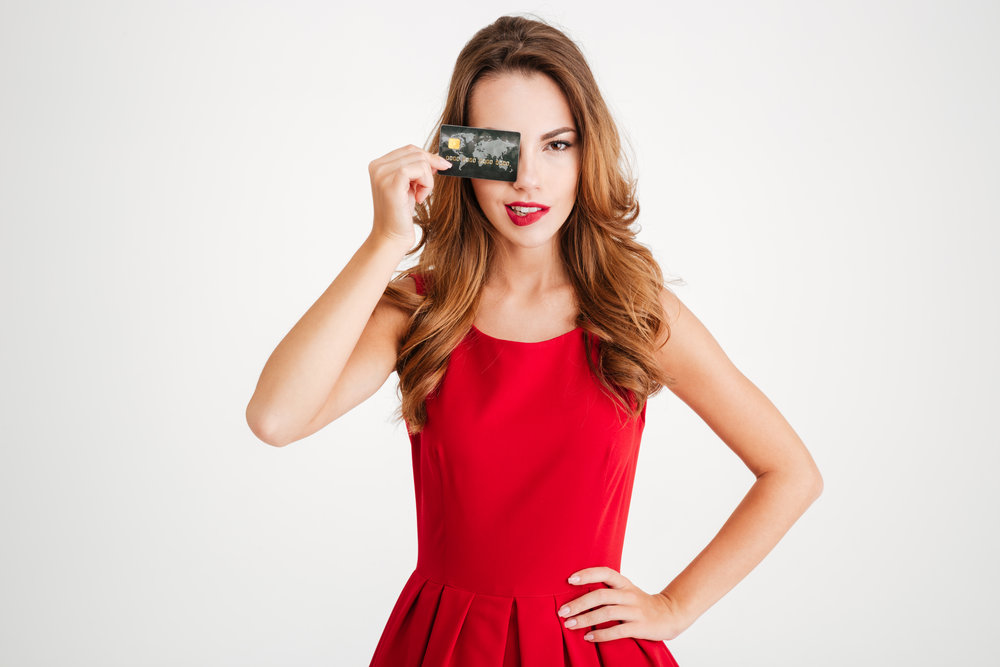 graphicstock-happy-attrctive-young-woman-holding-and-showing-credit-card_SdxNo1pBnx.jpg