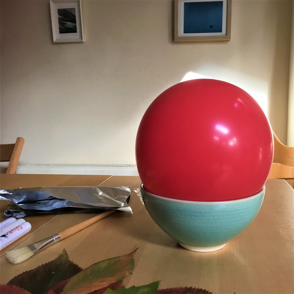 Fit the balloon snugly into your bowl