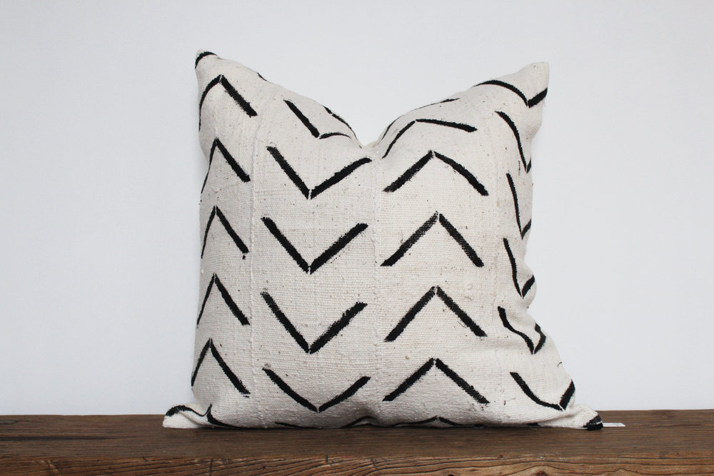 Chloe - No. 504   350 RMB  Pillow cover is made from African mudcloth sourced from Ghana.  Size: Roughly 50x50 cm  Pillow back is made from a neutral cotton/linen blend  White zipper on bottom of pillow  Down insert included  Hand wash only