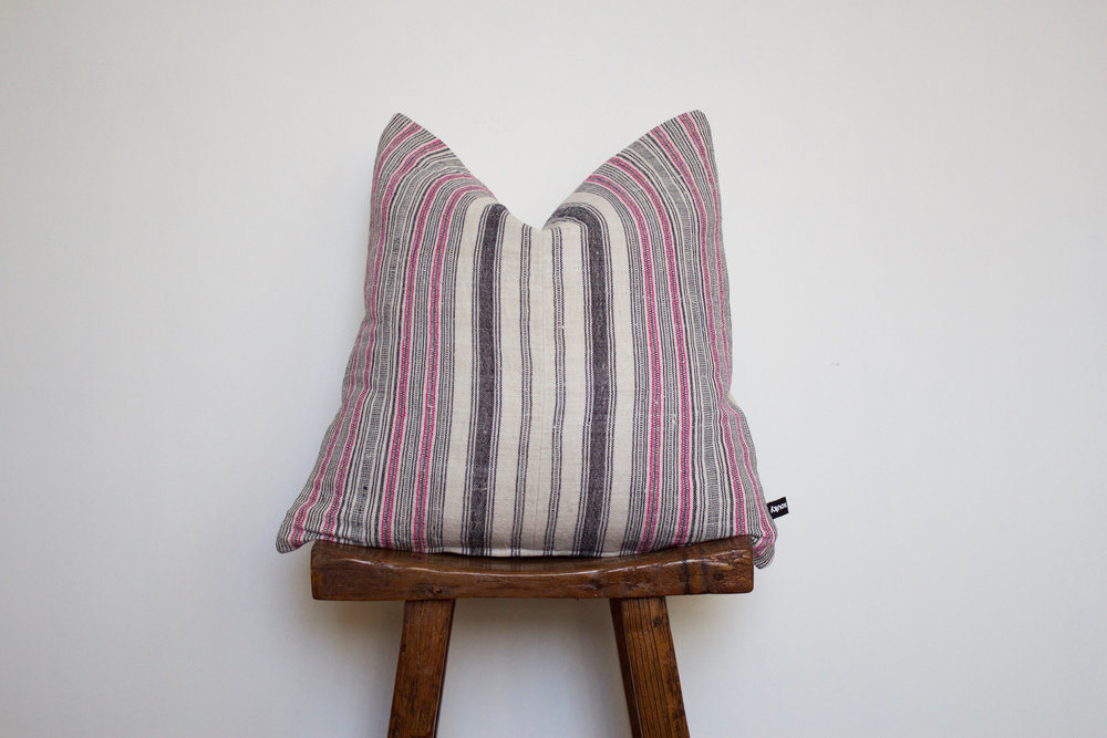 Finley - No. 137   350 RMB  Pillow cover is made from handwoven hemp fabric sourced from Northern Thailand  Size: Roughly 50x50 cm  Pillow back is made from a neutral cotton/linen blend  Zipper on bottom of pillow  Down insert included  Hand wash in cold water