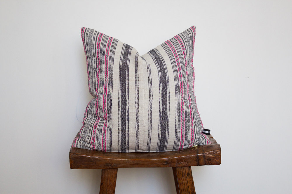 Finley - No. 142   275 RMB  Pillow cover is made from handwoven hemp fabric sourced from Northern Thailand  Size: Roughly 40x40 cm  Pillow back is made from a neutral cotton/linen blend  Zipper on bottom of pillow  Down insert included  Hand wash in cold water