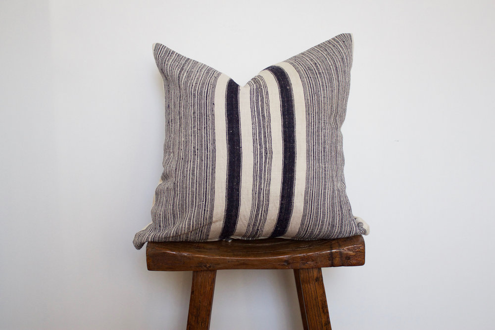 Tristen - No. 133   350 RMB  Pillow cover is made from handwoven hemp fabric sourced from Northern Thailand  Size: Roughly 50x50 cm  Pillow back is made from a neutral cotton/linen blend  Zipper on bottom of pillow  Down insert included  Hand wash in cold water
