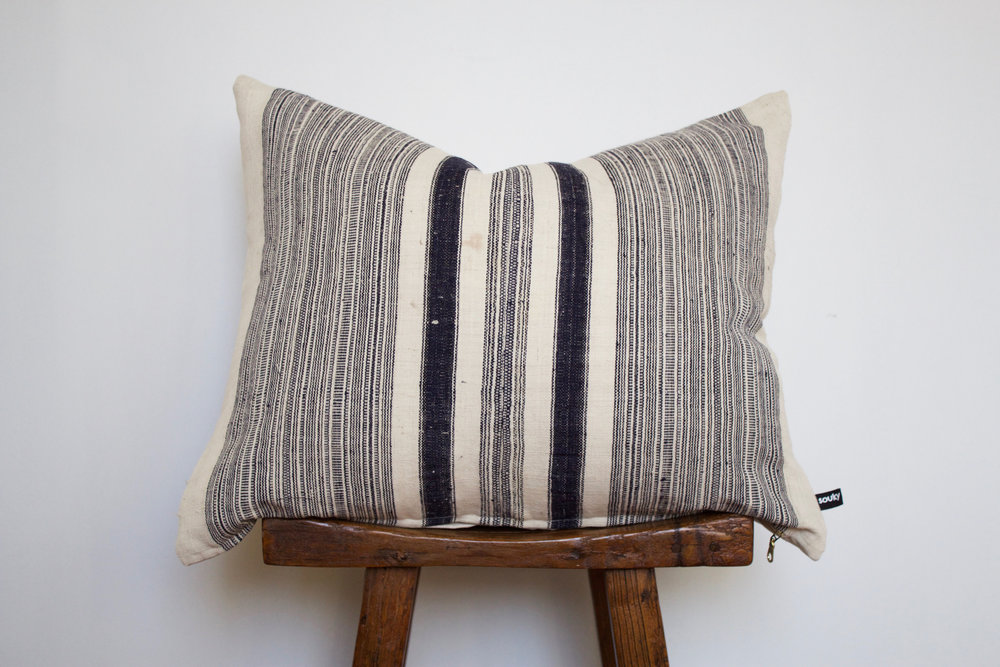 Tristen - No. 128   380 RMB  Pillow cover is made from handwoven hemp fabric sourced from Northern Thailand  Size: Roughly 60x50 cm  Pillow back is made from a neutral cotton/linen blend  Zipper on bottom of pillow  Down insert included  Hand wash in cold water