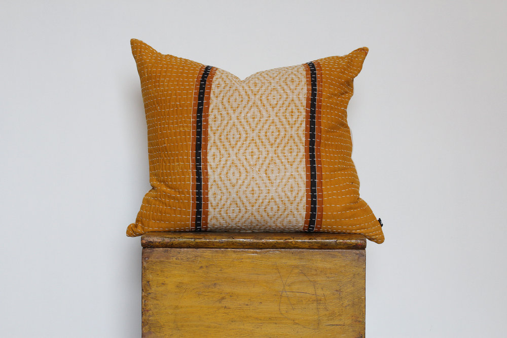 Charly- No. 801   300 RMB  Pillow cover is made from worn sari fabric sourced from India  Size: Roughly 51x45 cm  Pillow back is made from a neutral cotton/linen blend  Brass zipper on bottom of pillow  Down insert included  Hand wash and spot treat