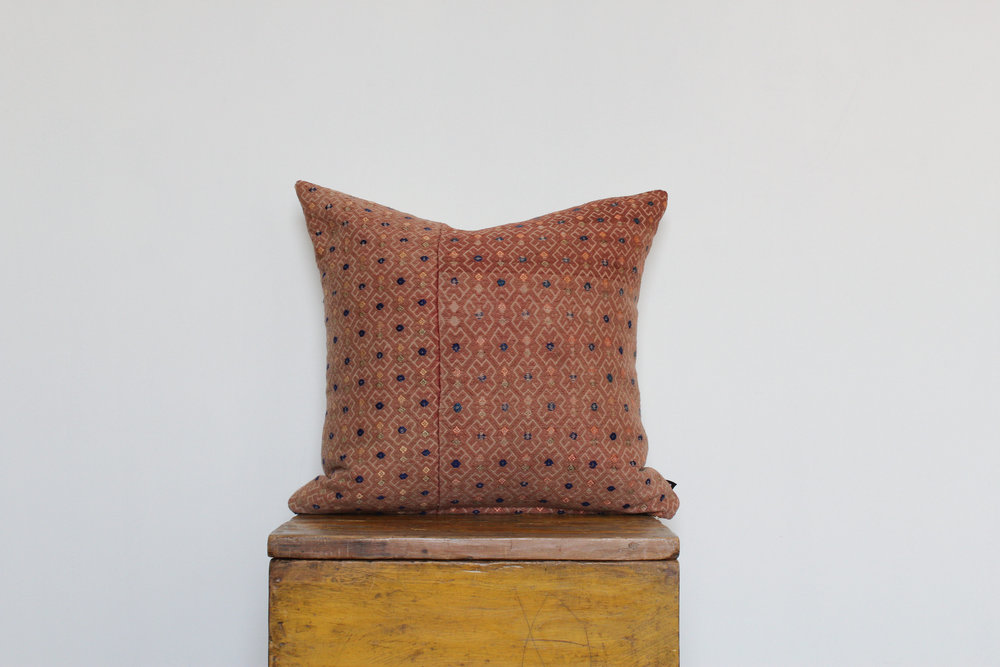 Molly - No. 201   280 RMB  Pillow cover is made from embroidered fabric used in traditional wedding blankets in southern China  Size: Roughly 50x50 cm  Pillow back is made from a neutral cotton/linen blend  Brass zipper on bottom of pillow  Down insert included  Hand wash and spot treat