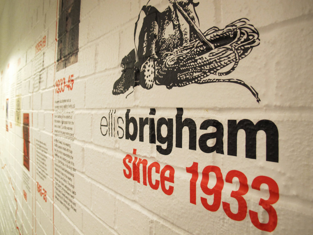 Conformable wall-wrap graphics depicting a historical timeline for the walls at Ellis Brigham's Covent Garden flagship store