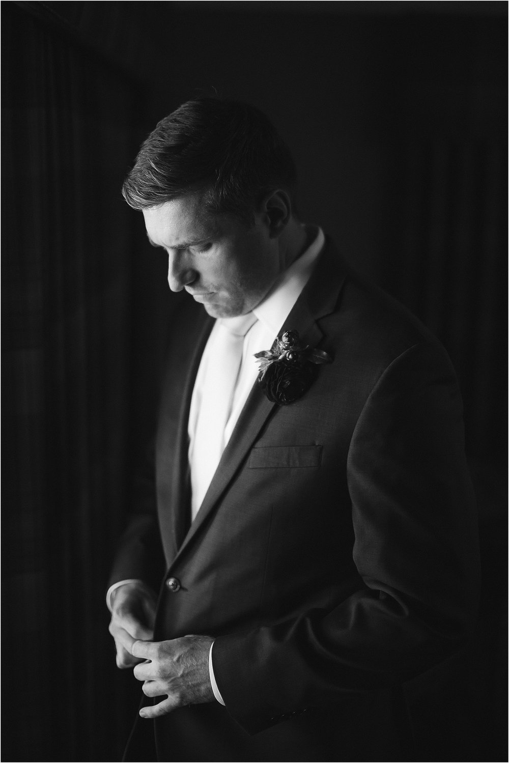 Black and white image of a groom