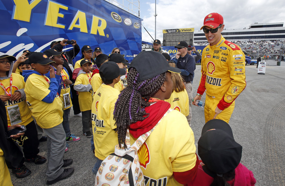 Dover students getting encouragement from Joey Logano before the start of the race- Delaware