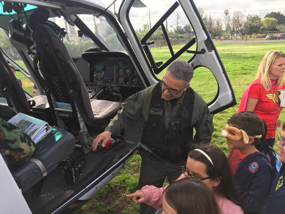Fuel for Success students go behind the scenes of a police helicopter.