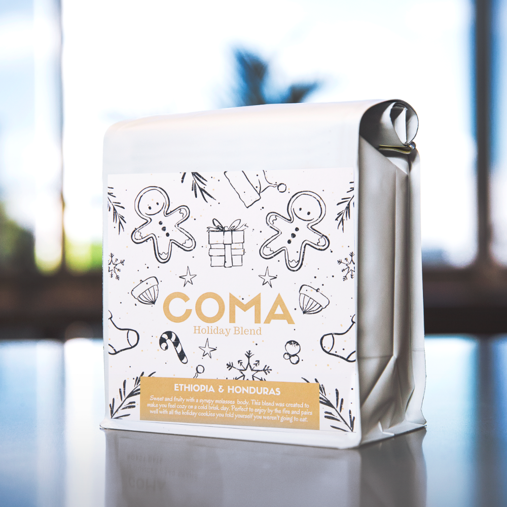 Holiday Blend - This is Coma's first blend so of course it made the list! Our holiday blend is a super fun and approachable cup of coffee anyone will enjoy! Combining coffees from Ethiopia and Honduras, this gift worthy blend carries a very rich, smooth feel with notes of chocolate and a light floral sweetness. We designed this blend to taste just as delicious in milk as it is black! So stay warm (or brew it cold!) while you celebrate the holidays and kick off the new year with this seasonal offering! $17.00