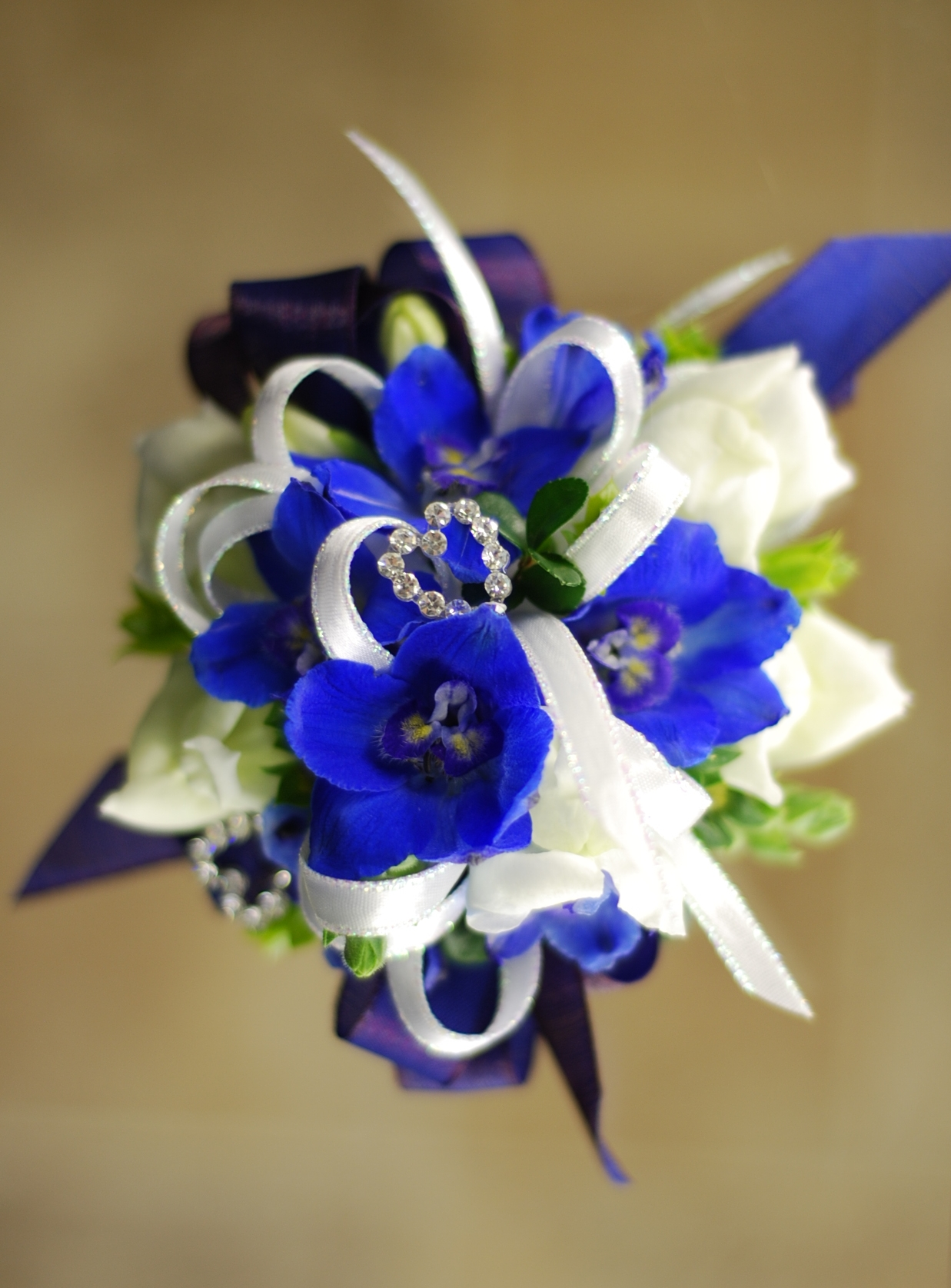 Wrist Corsage Royal Blue And White Amrose Flowers