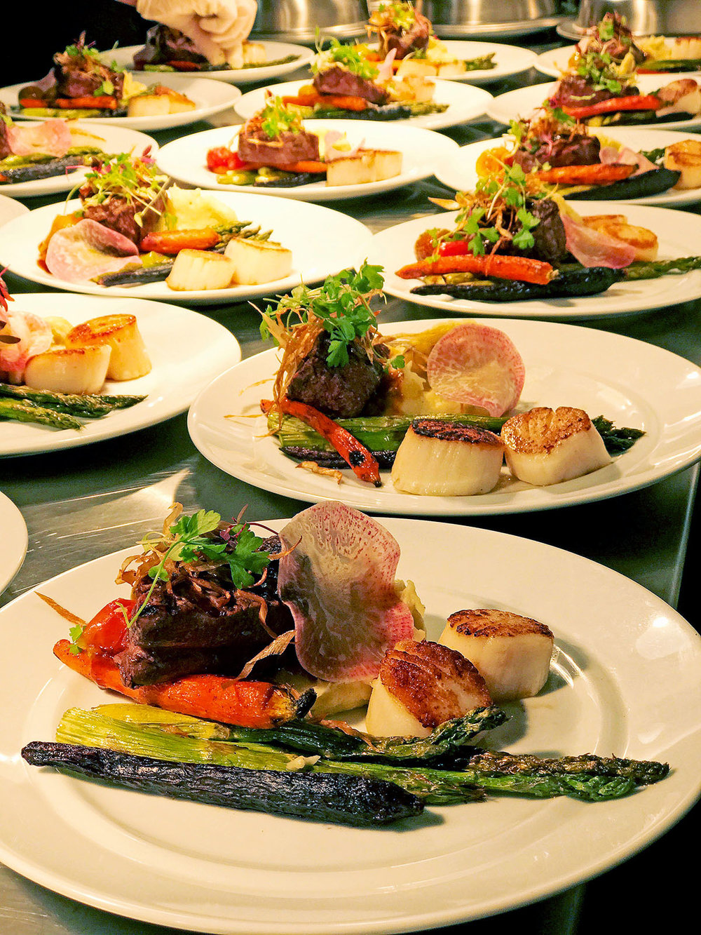 Our Chef featured a colorful Duo Plate of Beef Tenderloin & Diver Scallops with White Truffle Mashed Potatoes, Asparagus and Artisan Carved Baby Carrots topped with Toasted Leeks