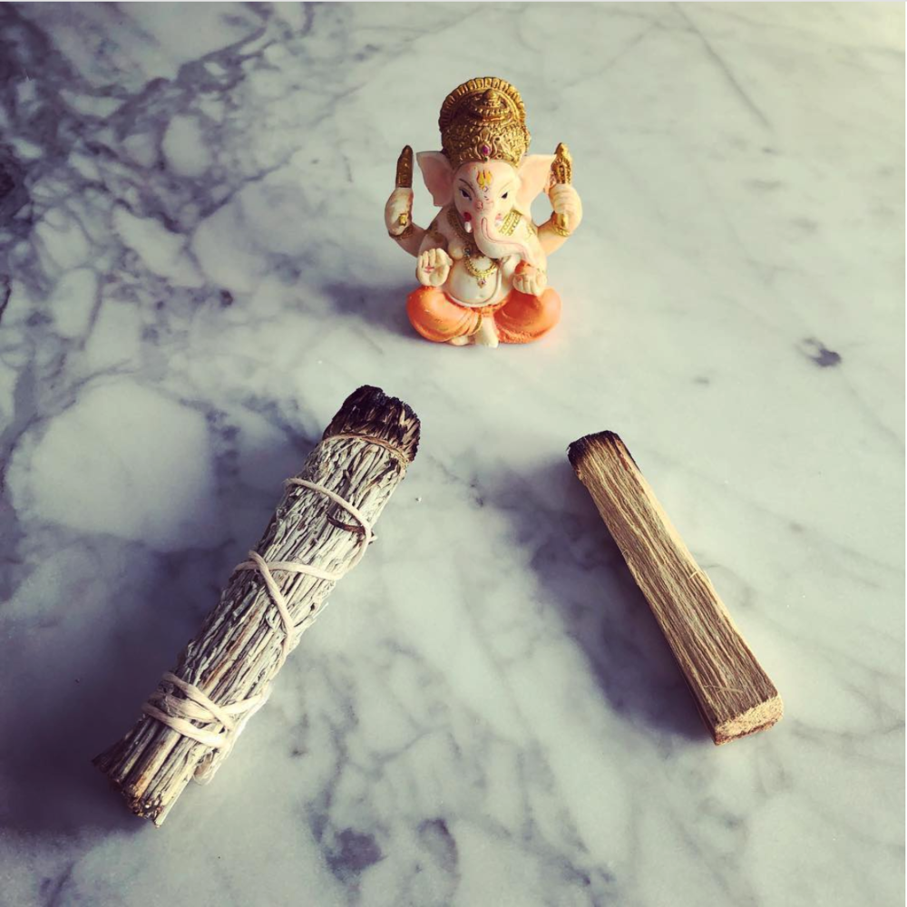 sage and palo santo energy cleansing