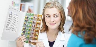 Pharmacist-with-card.jpg