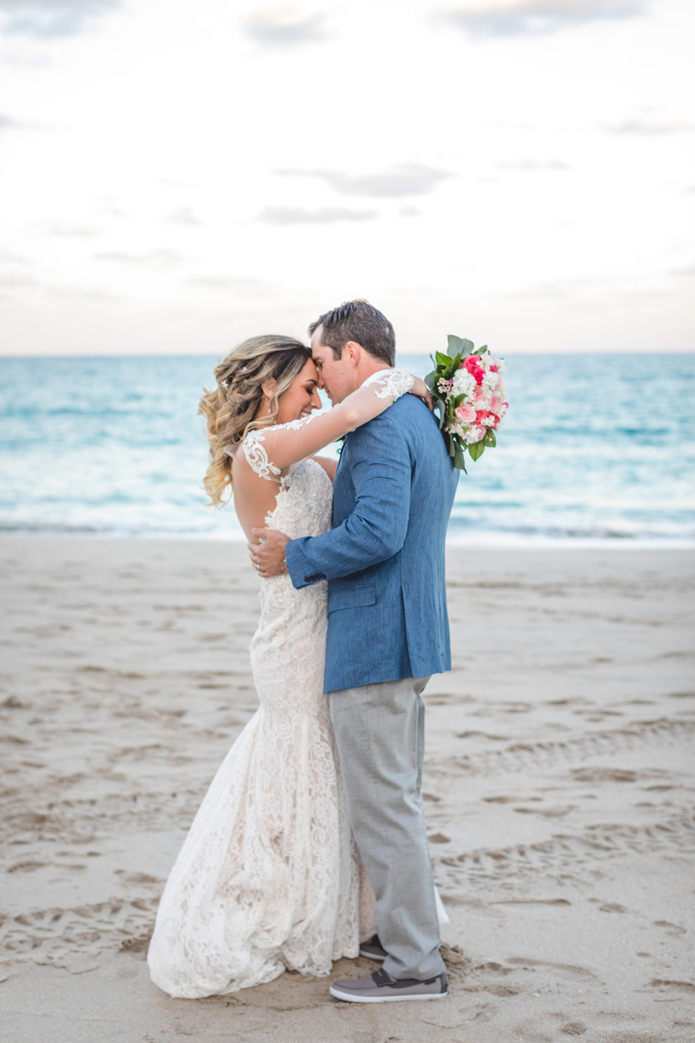 Catherine & Austin - This romantic beach wedding was nothing but stunning. Browse through the sandy ceremony and ballroom reception at the Pelican Grand Resort.