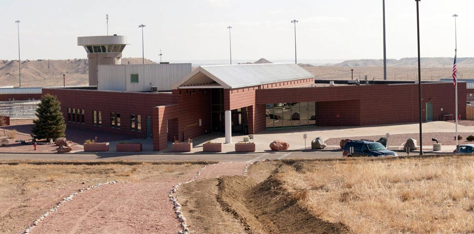 The entrance to the ADX Supermax in Florence, Colorado. After you check in here, it is the last time you are above ground (photo from Wikipedia).