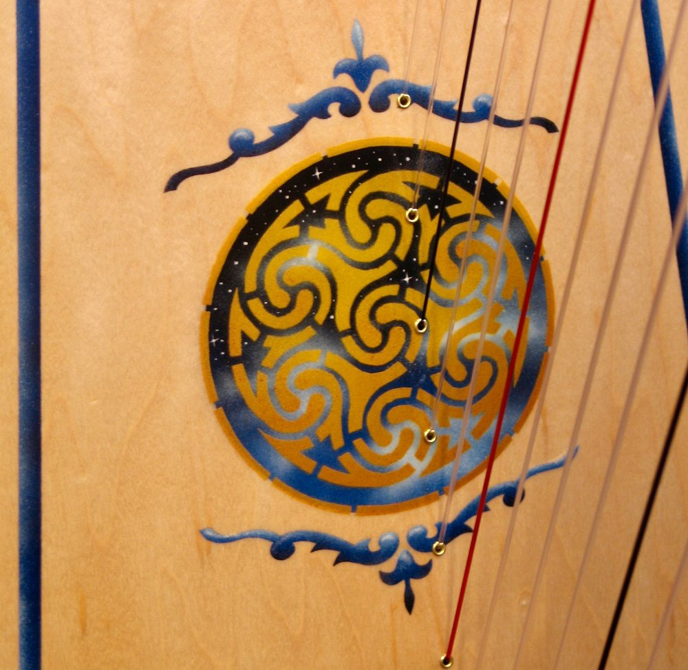 From our standard ornamentation catalog this is Starry, Starry Night in gold with a Celtic Border framing the soundboard.