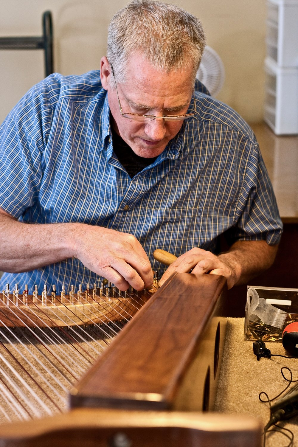 William Rees beginning the process of adding levers to a nearly completed harp.
